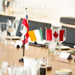 Montreal and Irish flags at meeting table