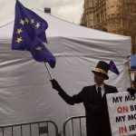 Brexit protester carrying an EU flag and a sign which reads My money's ON Brexit My money's IN Ireland Paul Dunne photographer